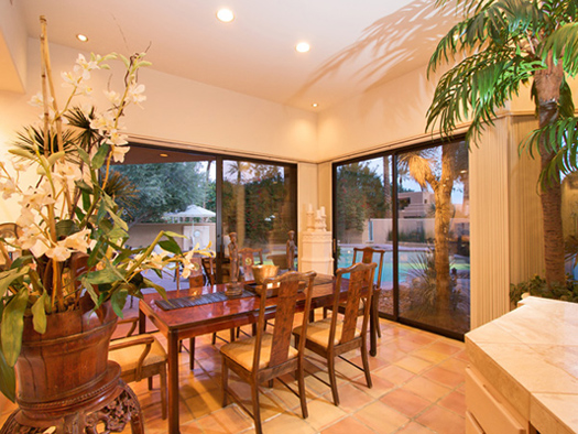 dining area with views of pool