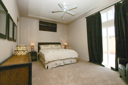 Generously sized master bedroom with slider to the pool area