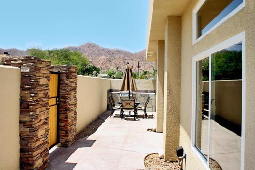 Courtyard surrounded by a perimeter privacy wall high enough to afford a very private setting